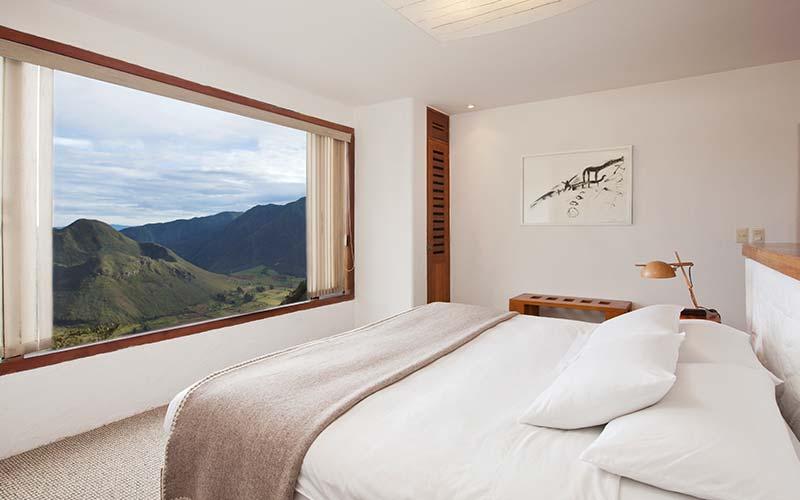 Het uitzicht vanuit de kamer in Landhuis-El-Crater in Ecuador