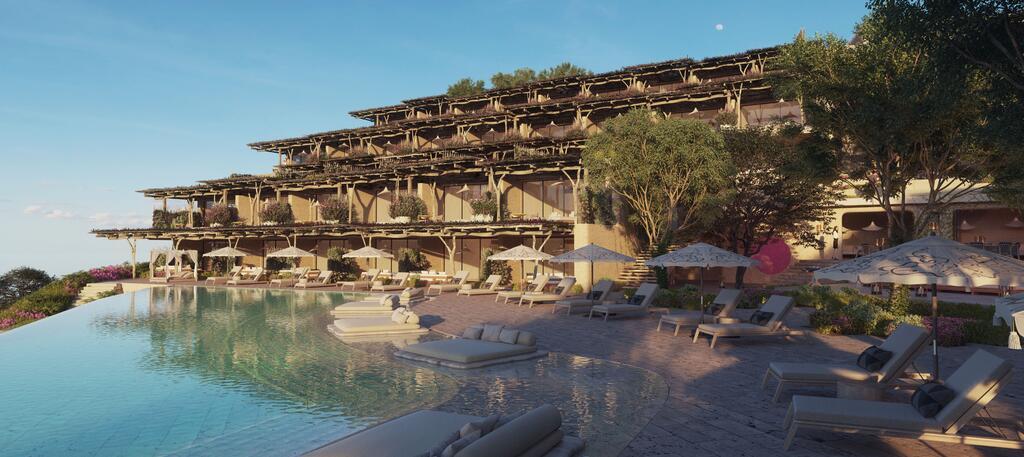Zwembad met ligbedden van Six Senses Ibiza