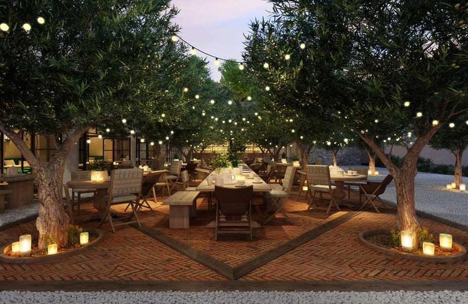 Terras en tuin van het hotel waar je kan eten